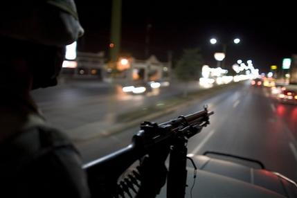Soldiers Patrolling the Street in Mexico 7 March 2009 via AP/Alexandre Menenghini