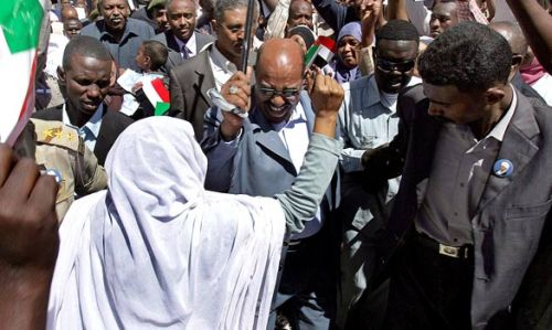 Bashir Denouncing Arrest Warrant Before Crowd via Times